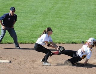 MASSILLON, OHIO - MAY 29, 2014: Base runner Jordan Youngs #17 of South Range is tagged out by infielder Katie George #27 of Independence to end the 4th inning during a OHSAA tournament game at Massillon Washington High School. Independence won 3-0. (Photo by David Dermer/Youngstown Vindicator)