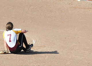 MASSILLON, OHIO - MAY 29, 2014: Pitcher Caragyn Yanek #7 sits on the ground after being struck in the ankle with a line drive hit in the 4th inning during a OHSAA tournament game at Massillon Washington High School. Independence won 3-0. (Photo by David Dermer/Youngstown Vindicator)