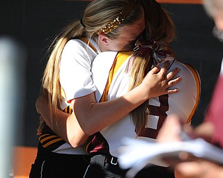 MASSILLON, OHIO - MAY 29, 2014: Codi Taylor #4 hugs teammate Stevie Taylor #4 in the dugout after a OHSAA tournament game at Massillon Washington High School. Independence won 3-0. (Photo by David Dermer/Youngstown Vindicator)