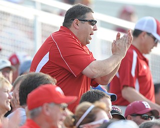 BLOOMINGTON, INDIANA - MAY 30, 2014: Fan Greg DiNello of Youngstown cheers from the stands after a Youngstown State out during Friday nights regional tournament game against Indiana University. (Photo by David Dermer/Youngstown Vindicator)