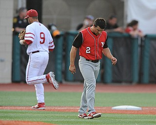 BLOOMINGTON, INDIANA - MAY 30, 2014: Base runner Mike Accardi #2 of Youngstown State hangs his head while walking across the infield after being stranded on third base and being unable to score a run during Friday nights regional tournament game against Indiana University. (Photo by David Dermer/Youngstown Vindicator) Indiana #9 Casey Rodrigue pictured.