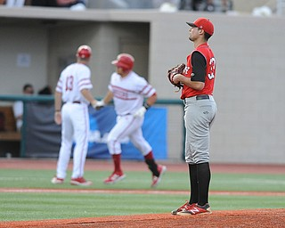 BLOOMINGTON, INDIANA - MAY 30, 2014: Pitcher Anthony Konders #33 of Youngstown State reacts to watching base runner Kyle Schwarber #10 of Indiana trot around the bases after hitting a 3 run home run during Friday nights regional tournament game against Indiana University. (Photo by David Dermer/Youngstown Vindicator)