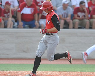 BLOOMINGTON, INDIANA - MAY 30, 2014: Base runner David Saluga #3 of youngstown State steps on home plate to score the first YSU run of the game during Friday nights regional tournament game against Indiana University. (Photo by David Dermer/Youngstown Vindicator)