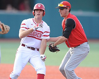 BLOOMINGTON, INDIANA - MAY 30, 2014: Infielder Phil Lipari #13 of Youngstown State tags out base runner Tim O'Conner #36 of Indiana after he was caught in a run down during Friday nights regional tournament game against Indiana University. (Photo by David Dermer/Youngstown Vindicator)