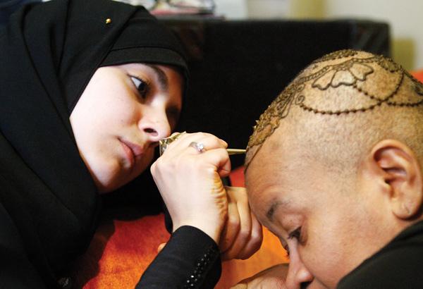 Photos   vindy com – Lamia Alfares, a local Henna artist