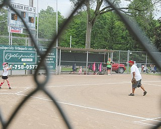 A softball game was one of the contests played Monday at the Mill Creek Junior Baseball League's Kramer Field