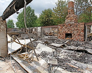 Rubble remains after a Tuesday-morning fire at a clubhouse owned by the Mahoning County Coon Hunters Protective Association. The clubhouse was more than 30 years old and will be rebuilt.