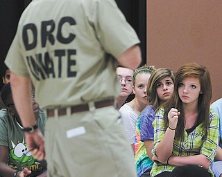 Ohio Department of Rehabilitation and Correction inmate Paul Fitzpatrick of the Grafton Correctional Institution in Grafton, Ohio, talks to eighth grader Taylor Davies and other students at W.S. Guy Middle School in Liberty.