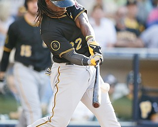 Pittsburgh's Andrew McCutchen hits a fly ball while batting against San Diego during the eighth inning Wednesday night. The Padres beat the Pirates, 3-2.