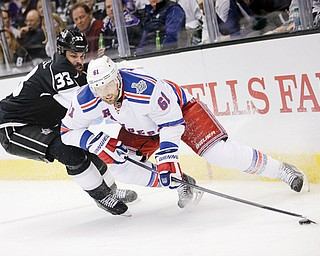 New York Rangers left wing Rick Nash, right, skates around Los Angeles Kings defenseman Willie Mitchell during the first period of Game 1 in the Stanley Cup Final on Wednesday night.