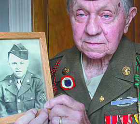 William D Leiws the vindicator WWII vet and Normandy survivor John E. Bistrica of Youngstown holds a photo of himself taken in 1943 when he joined the military.