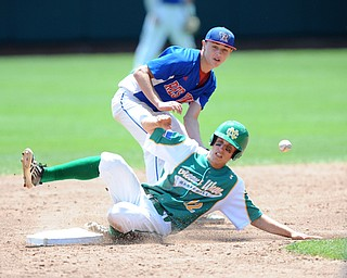 COLUMBUS, OHIO - JUNE 5, 2014: Base runner Zach Wollenburg #12 of Newark Catholic steals second base after infielder Wyatt Larimer #9 of Reserve misplays the baseball during the bottom of the 3rd inning during a OHSAA state semi-final game at Huntington Park. Newark Catholic won 6-2. (Photo by David Dermer/Youngstown Vindicator)