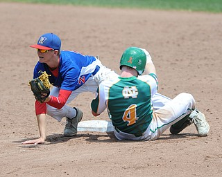 COLUMBUS, OHIO - JUNE 5, 2014: Infielder Walker Marloew #2 of Reserve shows the ball to the umpire after tagging out Rob Engle #4 of Newark Catholic who was trying to steal second base, this would be the 3rd out of the bottom of the 4th inning during a OHSAA state semi-final game at Huntington Park. Newark Catholic won 6-2. (Photo by David Dermer/Youngstown Vindicator)