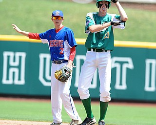 COLUMBUS, OHIO - JUNE 5, 2014: Base runner Conor Keck #21 of Newark Catholic celebrates after hitting a 2 RBI double in the bottom of the 6th inning during a OHSAA state semi-final game at Huntington Park. Newark Catholic won 6-2. (Photo by David Dermer/Youngstown Vindicator) Reseve #2 Walker Marlowe pictured.