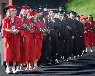 Soon-to-be graduates of Campbell Memorial High School line the track at Campbell Memorial Stadium before the start of Thursday's commencement. This year's graduating class had 76 students.