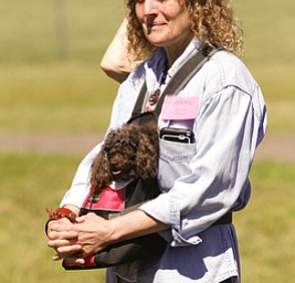 ROBERT K. YOSAY  | THE VINDICATOR..Dianna Sippl and 'shiloh' her minature poodle.. enjoy the ribbon cutting. .Animal Welfare League of Trumbull county ribbon cutting on Belmont Ave across from Squaw Creek in Vienna.