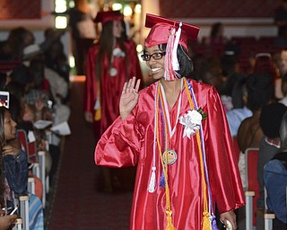 Katie Rickman | The Vindicator.Janay Robinson, Valedictorian, waves to as she walks into the auditorium  for graduation at Chaney High School June 6, 2014.