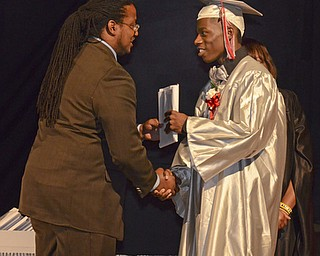 Katie Rickman | The Vindicator.James Gordon recieves his diploma from Ronald Shadd at Chaney High School commencement June 6, 2014.