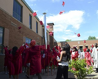 Katie Rickman | The Vindicator.Chaney students throw their hats into the air after commencement June 6, 2014.