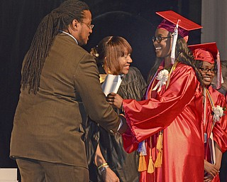 Katie Rickman | The Vindicator.Tryra Withers receives her diploma from Ronald Shadd at the Chaney High School Commencement June 6, 2014.