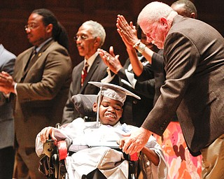ROBERT K. YOSAY  | THE VINDICATOR.. Michael Murphy Youngstown School Board congratulates Kahlil BOwen on his diploma... East  High School   graduation Friday morning at Stambaugh Auditorium