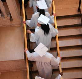 ROBERT K. YOSAY  | THE VINDICATOR.. class of 2014 East High climb the stairs heading to graduation.. East  High School   graduation Friday morning at Stambaugh Auditorium