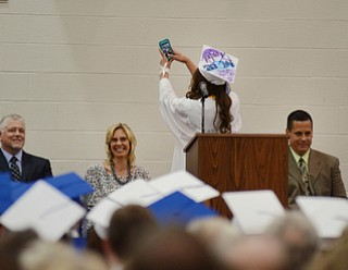 "Katie Rickman | The Vindicator   .Valedictorian Taylor Tharp takes a ""selfie"" saying ""I want to remember where I came from..."" Board of Education members laugh as they watch her turn and take a photo. L-R on stage Mitch Mascioli, Michele Catania, Taylor Tharp, and Principal David Vega."
