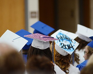 Katie Rickman | The Vindicator.Students with decorated hats sit in the audience at Jackson Milton's graduation June 6 ,2014.