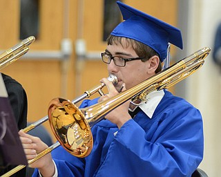 Katie Rickman | The Vindicator   .Tibius Kegley plays the trumbone during the bands performance of The Phantom of the Opera at Jackson Milton's graduation ceremony June 6, 2014.