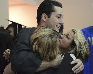 Katie Rickman | The Vindicator.John Meadows hugs his his Aunts Kathy Barschows (left) of New Jersey and Cynthia Alonge of New York after graduating from Mahoning County High School. The day was an emotional day for the family as John's mother Deborah Meadows passed away two years ago in August.