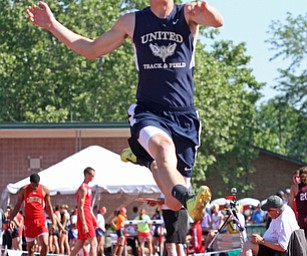 Riley Fillman of Hanoverton United  jumps in the long jump of Division 2 State Track Meet at the Jesse Owens Memorial Stadium in Columbus, Ohio, Friday, June 6, 2014. (Photo/Mark Hall)