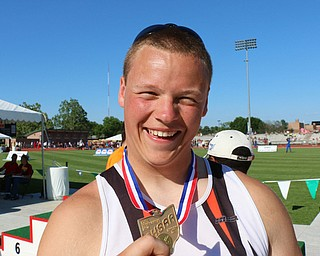 Bucyrus Palo of Newton Falls is all smiles as he holds up the first place medal for winning the states Division 3 Boys discus at the Jesse Owens Memorial Stadium in Columbus, Ohio, Friday, June 6, 2014. (Photo/Mark Hall)