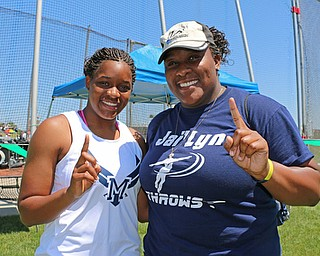 Jai' Lynn Mosley of McDonald poses with her older sister, Joh' Vonnie, after winning the discus event in the Division 3 State Meet at the Jesse Owens Memorial Stadium in Columbus, Ohio, Friday, June 6, 2014. Joh' Vonnie also won this event 4 years ago. (Photo/Mark Hall)