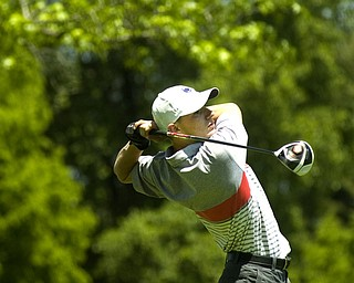Kelli Cardinal/The Vindicator.Bradley Miller, 17, of Hanoverton, tees off Saturday on the back nine during the Greatest Golfer of the Valley junior series at Mohawk Trails Golf Course in New Castle.