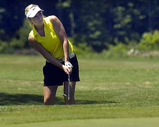 Kelli Cardinal/The Vindicator.Alexa Tringhese, 16, of Columbiana, chips up to the green Saturday on the back nine during the Greatest Golfer of the Valley junior series at Mohawk Trails Golf Course in New Castle.