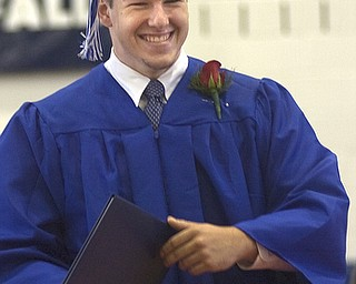 Kelli Cardinal/The Vindicator.Graduate Griffin Marr walks back to his seat Sunday after receiving his diploma during the commencement ceremony at Poland Seminary High School.