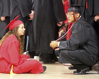 William D Lewis The Vindicator Canfield 2014 grads Mallory Allen and Ernie Barkett take a break before Sunday commencement at CHS. Allen was one of the commencement speaks and Barkett was a co class president.
