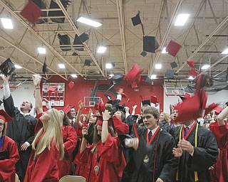 William D Lewis The Vindicator Canfield 2014 grads toss their caps into the air during Sunday commencement at CHS.