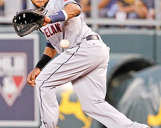Cleveland first baseman Carlos Santana fields a ground ball hit by Kansas Cit's Mike Moustakas in the fourth inning Tuesday night. The Royals beat the Indians, 6-2, in the first game of a two-game series in Kansas City.