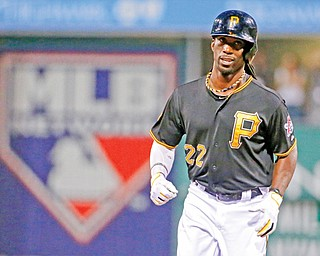 The Pirates' Andrew McCutchen rounds second after hitting a two-run home run off Cubs starting pitcher Jason Hammel during the first inning of their baseball game Wednesday at PNC Park in Pittsburgh. McCutchen reached base four times in the Pirates' 4-2 win.