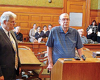 John Bruce Barton spoke in court to Judge Ronald Rice on Wednesday asking for former Niles funeral director Robert P. McDermott Sr. to receive 20 years in prison for the theft of $270,000 from about 50 of his former customers, including Barton. At left is Chuck Morrow, assistant Trumbull County prosecutor. Many other victims were in the courtroom behind Barton.
