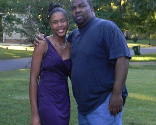 Earl Reynolds is shown with his daughter, Angelique Reynolds in Charlotte.
