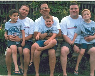 Gathered, from left, are Stephen Pacheco holding his son, Stephen Q. of Canfield; Papa Will holding grandson, Alec Will; and Vincent Pacheco with his son Vincent Jr. of Pittsburgh. The photo was taken at a July 4 picnic at PapaÕs house. Sent by Grandma Aida.