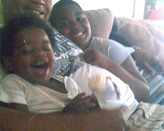 Jerome Givens with his sons Maleik, left, and Isiah.