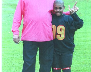 Jerome Givens and his son Isiah are agreeing they are Number One!