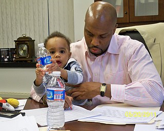 Father and son, Harry L. Johnson III and Harry Liam Johnson are at daddyÕs office in City Hall. Sent by Jaci Johnson.
