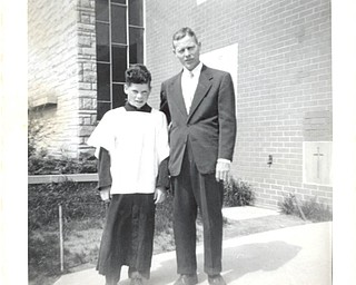Altar boy, Tommy Dailey, with his father, Joseph E. Dailey, in 1956, are preparing to attend a Mass to honor fathers on Father's Day at St. Christine Church in Youngstown. Tommy's father is his hero.
