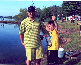 Christopher Calfee with his son, Brandon, catching Brandon's first fish May 31 at Evans Lake in Canfield. Sent by Nana Wittenauer of Youngstown.