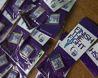Kelli Cardinal/The Vindicator.Caregiver pins are displayed Friday on the registration table at the 2014 Austintown Relay For Life event in Austintown Township Park.