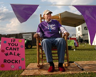 Kelli Cardinal/The Vindicator.Mike Griffin, of Austintown, watches the walkers Friday during the 2014 Austintown Relay For Life event in Austintown Township Park.  Griffin has been battling advanced colon cancer for five years.